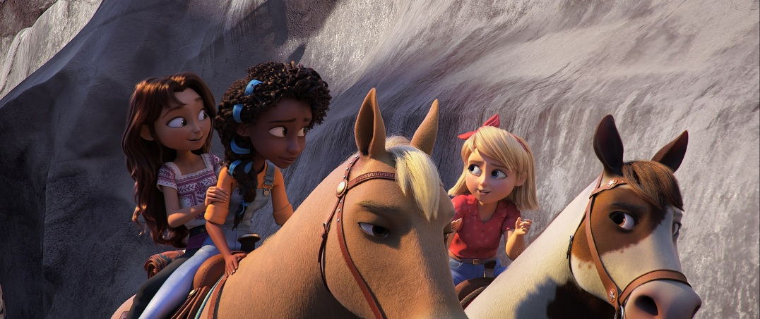 (from left) Lucky Prescott (Isabela Merced) and Pru Granger (Marsai Martin) riding Chica Linda and Abigail Stone (Mckenna Grace) riding Boomerang in DreamWorks Animation's Spirit Untamed, directed by Elaine Bogan.