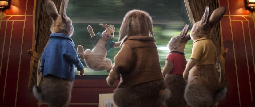 Peter Rabbit (James Corden), Benjamin (Colin Moody), Mopsy (Elizabeth Debicki), Flopsy (Margot Robbie) watch Cottontail (Aimee Horne) having some fun in Columbia Pictures' PETER RABBIT™ 2: THE RUNAWY.