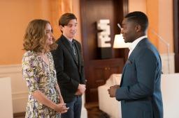 Nigel Basil Jones (David Oyelowo) greeting Mr. McGregor (Domhnall Gleeson) and Bea (Rose Byrne) in his office in Columbia Pictures' PETER RABBIT™ 2: THE RUNAWAY.