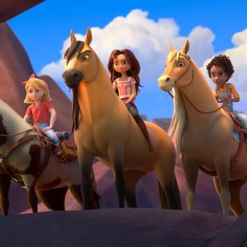 (from left) Abigail Stone (Mckenna Grace) riding Boomerang, Lucky Prescott (Isabela Merced) riding Spirit and Pru Granger (Marsai Martin) riding Chica Linda in DreamWorks Animation's Spirit Untamed, directed by Elaine Bogan.
